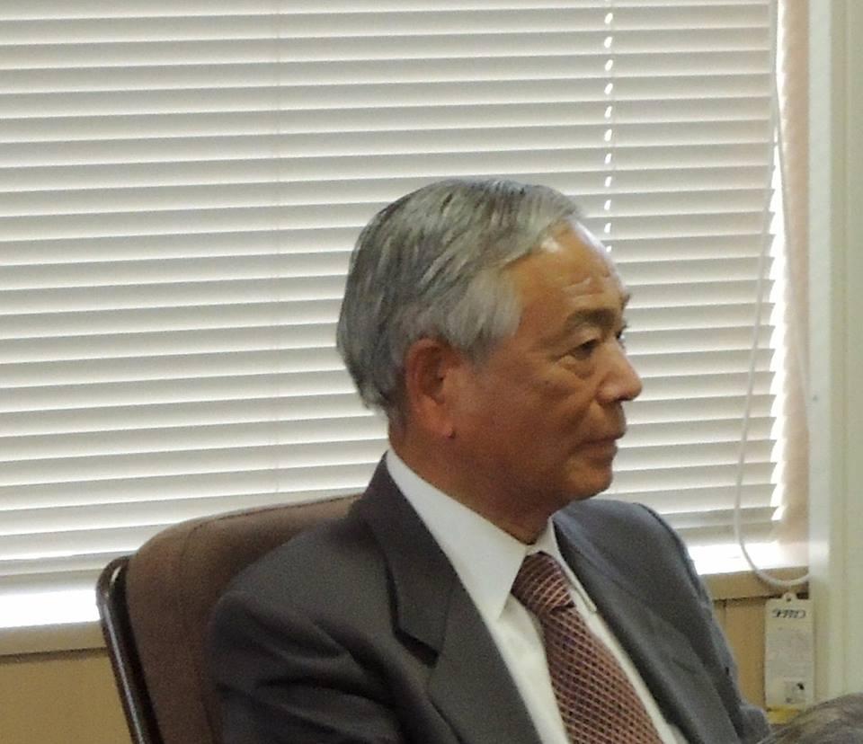 報告集会での竹本修三さん